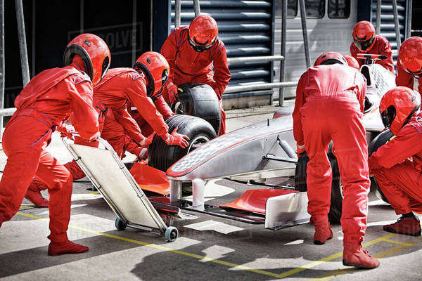 Racing team working at pit stop Royalty-free stock photo