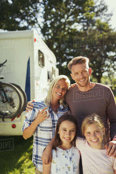 Portrait smiling affectionate family outside sunny motor home Royalty-free stock photo