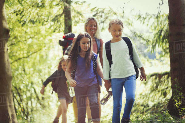 Mother and daughters hiking in woods Royalty-free stock photo