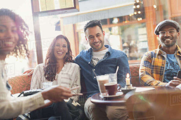 Portrait smiling friends hanging out in cafe Royalty-free stock photo
