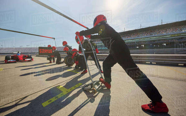 Pit crew preparing for formula one race car pit stop in pit lane Royalty-free stock photo