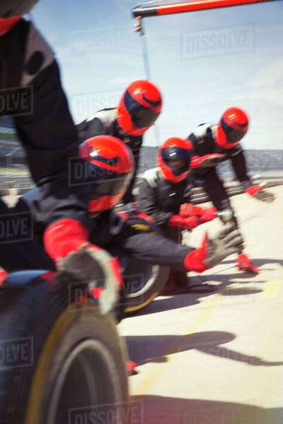 Pit crew with tires ready in pit lane Royalty-free stock photo