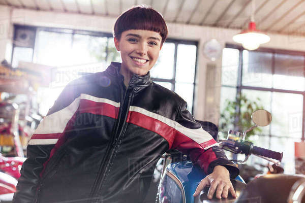 Portrait confident female motorcycle mechanic in workshop Royalty-free stock photo