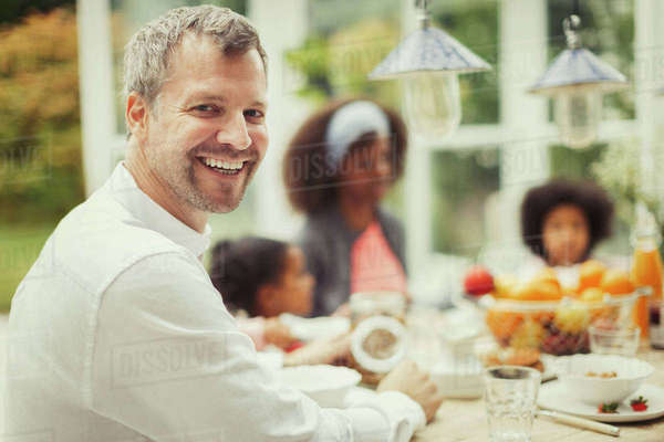 Portrait enthusiastic father with family at breakfast table Royalty-free stock photo