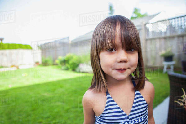 Portrait girl in bathing suit in summer backyard Royalty-free stock photo