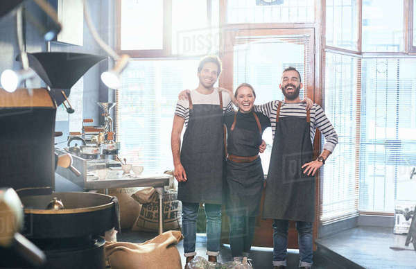 Portrait smiling coffee roasters in aprons Royalty-free stock photo