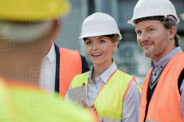 Smiling engineers meeting at construction site Royalty-free stock photo