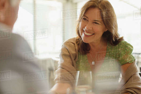 Smiling mature woman enjoying date, dining at restaurant Royalty-free stock photo