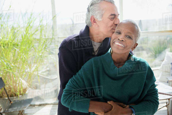 Portrait affectionate senior couple hugging and kissing Royalty-free stock photo