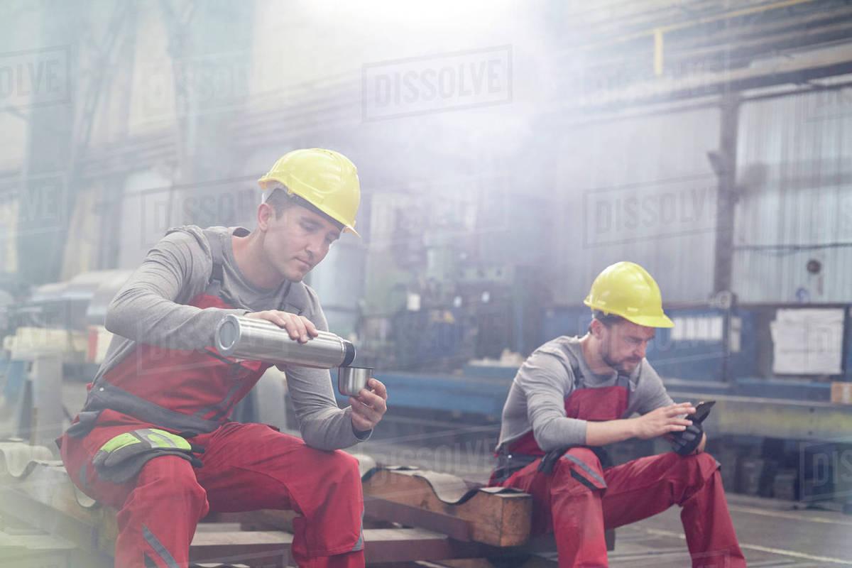 Take Break Coffeebreak : Factory workers taking coffee break stock photo dissolve