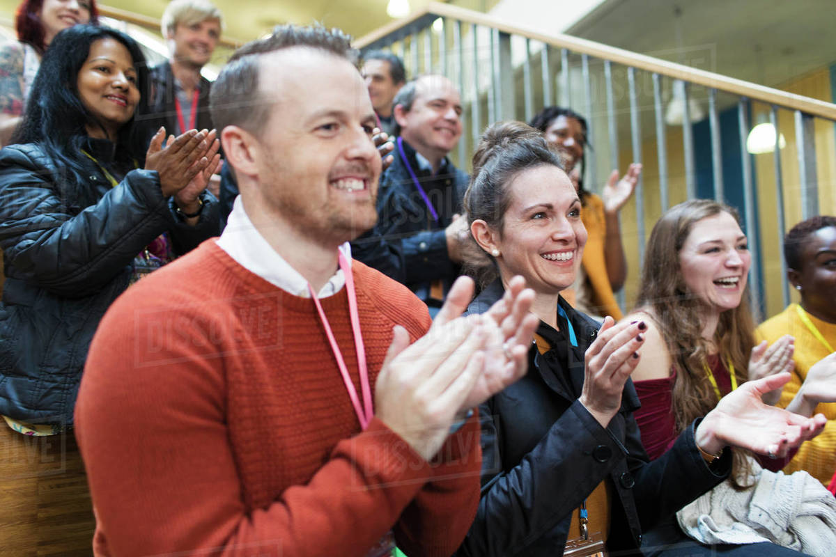 smiling conference audience clapping stock photo dissolve