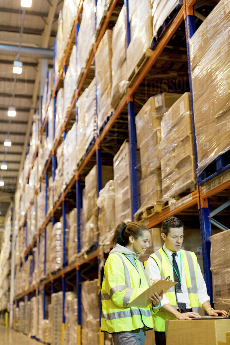 Workers talking in warehouse Royalty-free stock photo