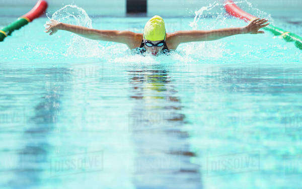 Swimmer racing in pool Royalty-free stock photo