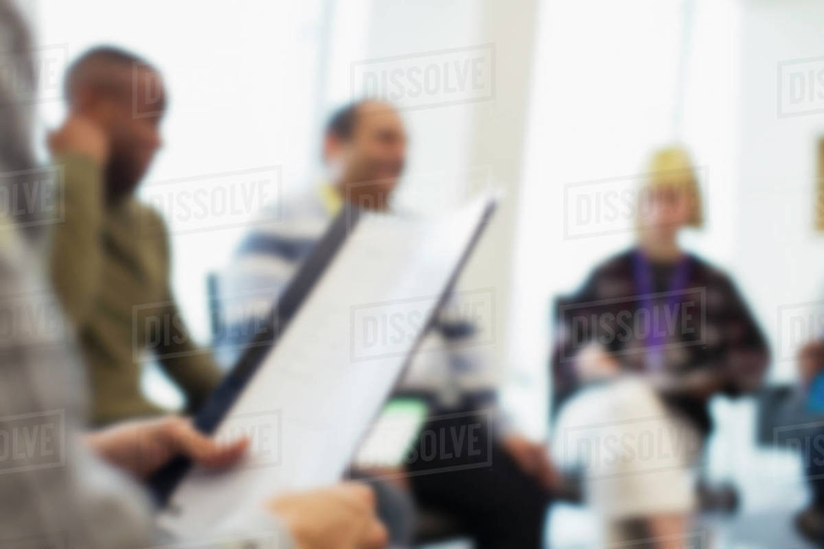 Close up businessman holding paperwork in meeting Royalty-free stock photo