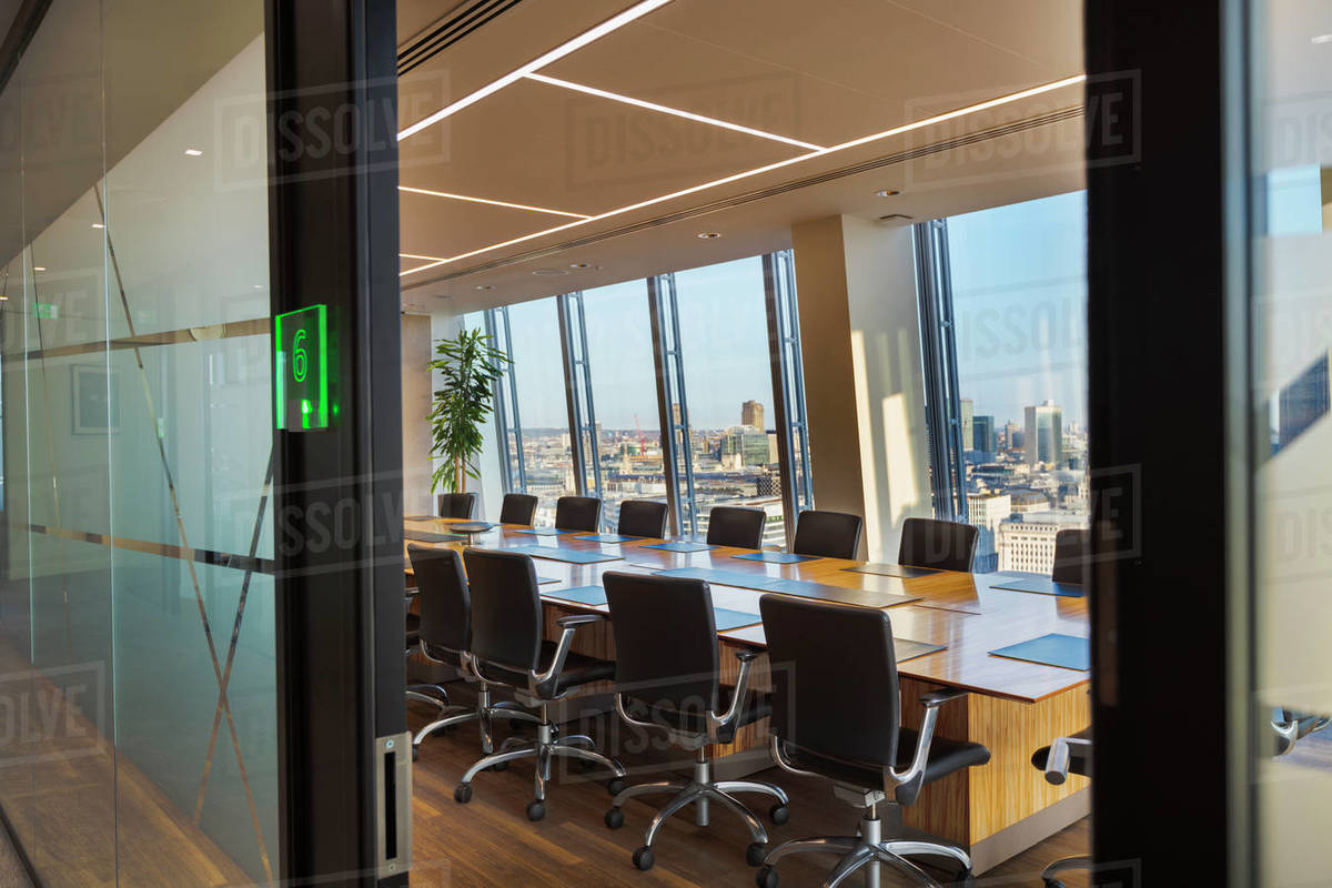 Modern urban conference room with long table and chairs Royalty-free stock photo