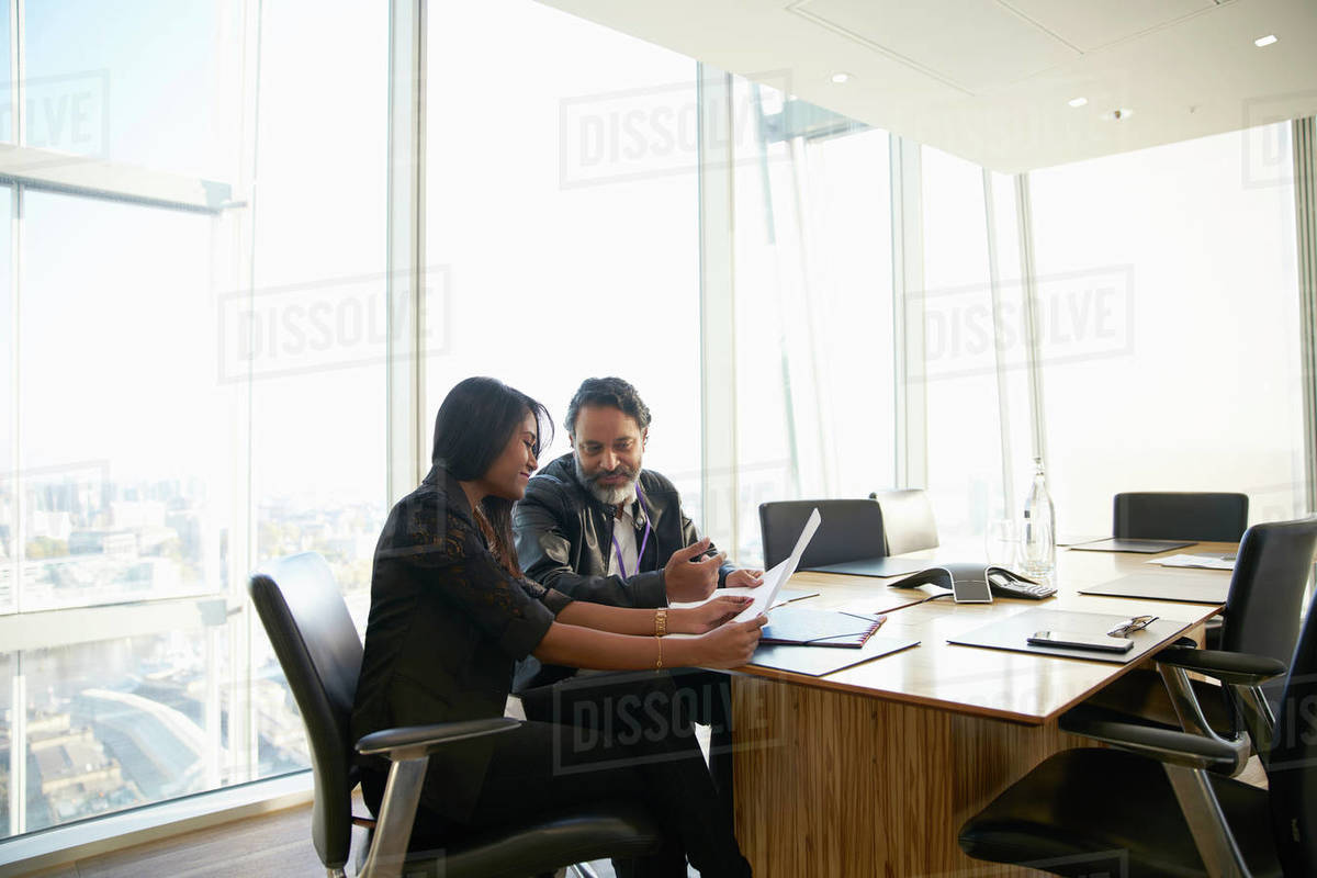 Business people discussing paperwork in conference room meeting Royalty-free stock photo