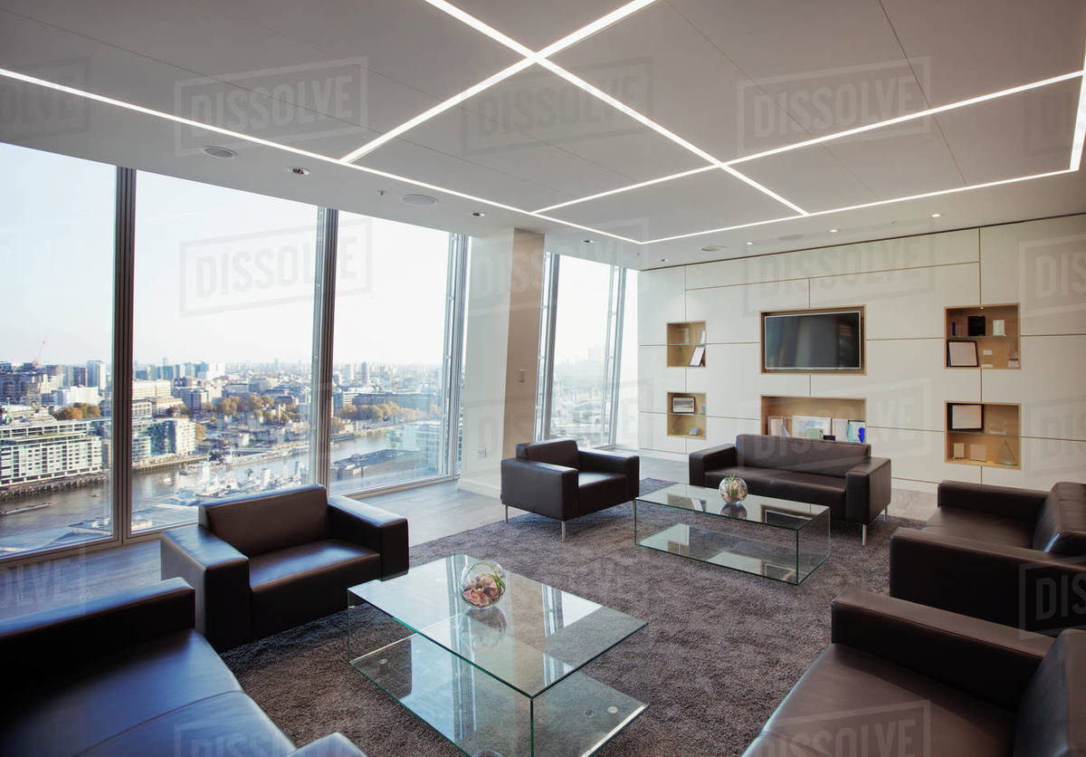 Modern highrise business office lobby overlooking city Royalty-free stock photo