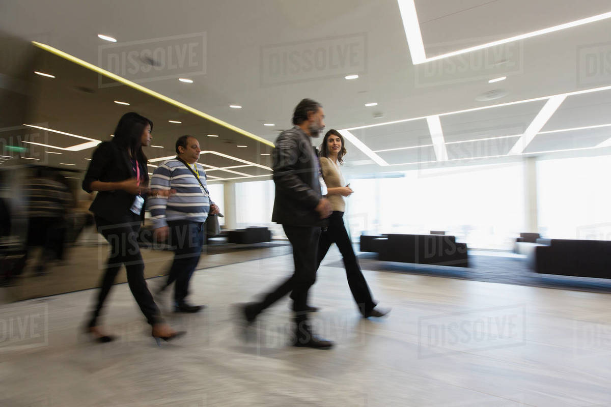 Business people walking in office lobby Royalty-free stock photo