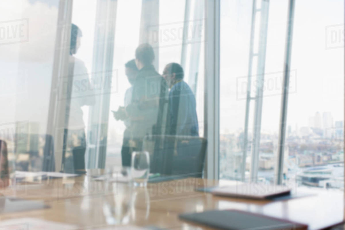 Business people talking at urban highrise office window Royalty-free stock photo