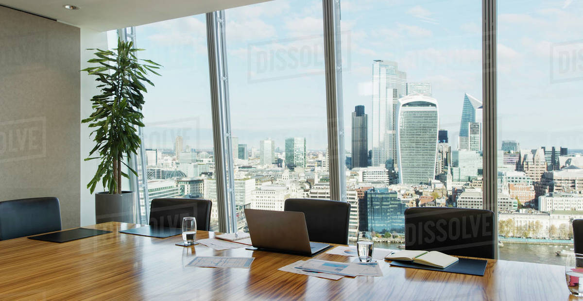 Laptop on conference room table in highrise office Royalty-free stock photo