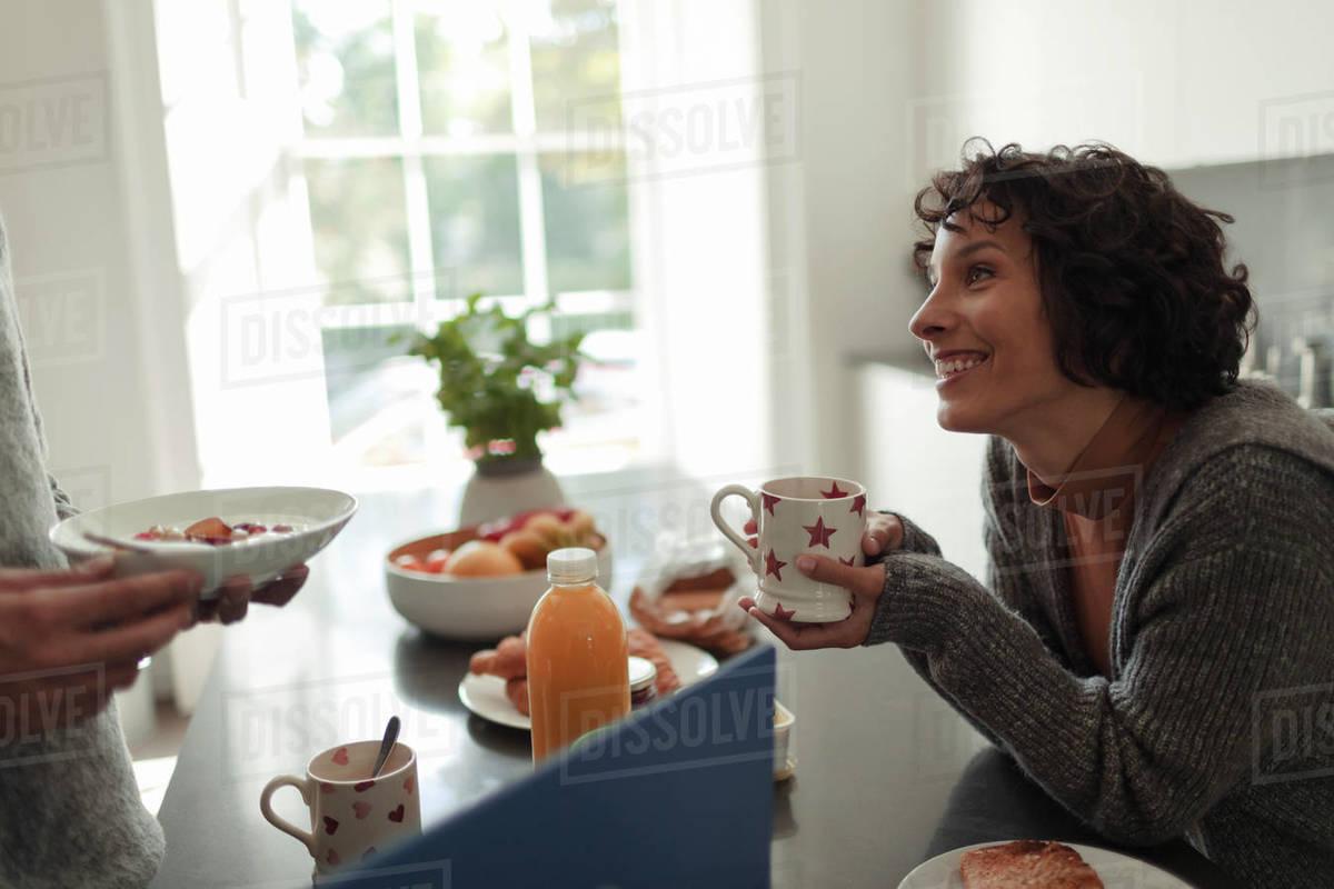 Happy couple enjoying breakfast at kitchen counter Royalty-free stock photo