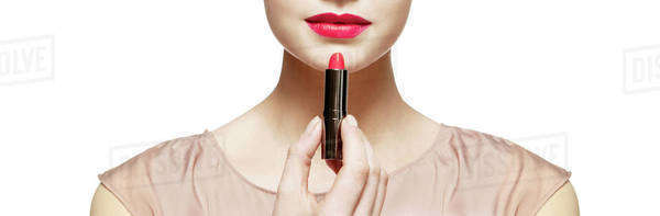 Close up of woman applying red lipstick Royalty-free stock photo