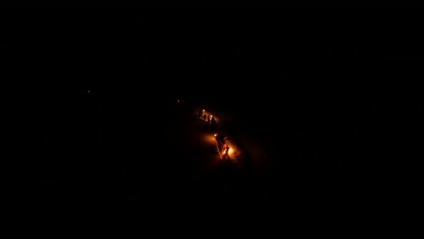 Aerial shot of people standing in snow with burning torches Royalty-free stock video