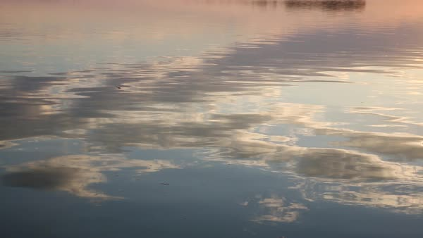 Hand-held shot of reflection of clouds in the water Royalty-free stock video