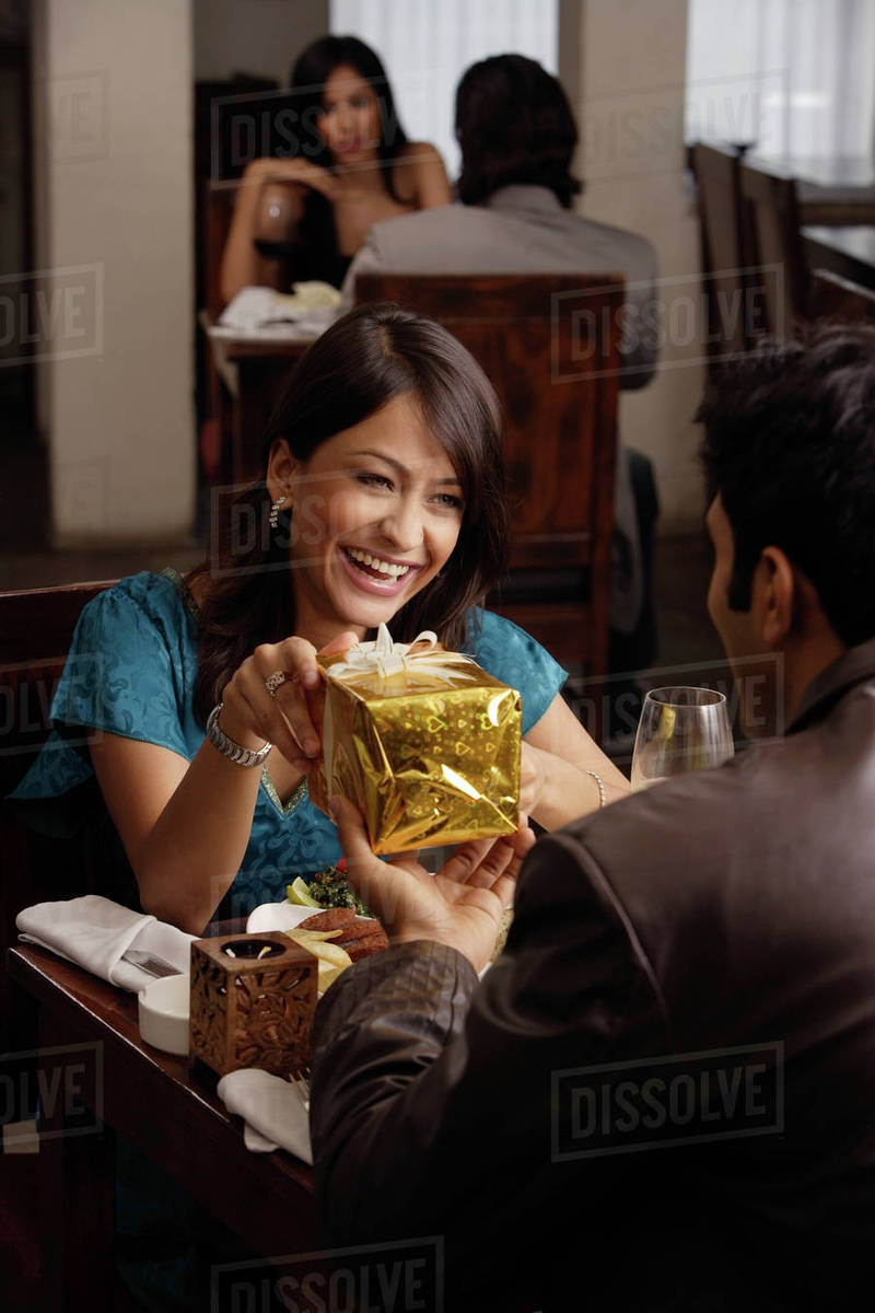 Young Man Giving Present To Woman