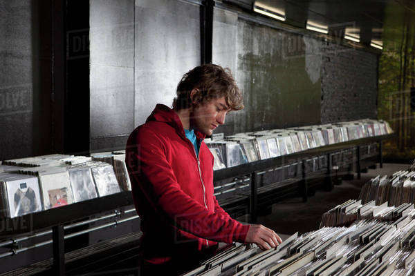 A young man looking through records at a record store Royalty-free stock photo