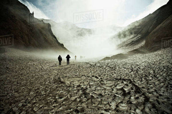 Hikers trekking through the Mutnovsky Volcano, Kamchatka, Russia Royalty-free stock photo