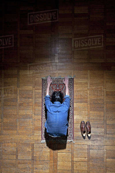 A man praying on a mat Royalty-free stock photo