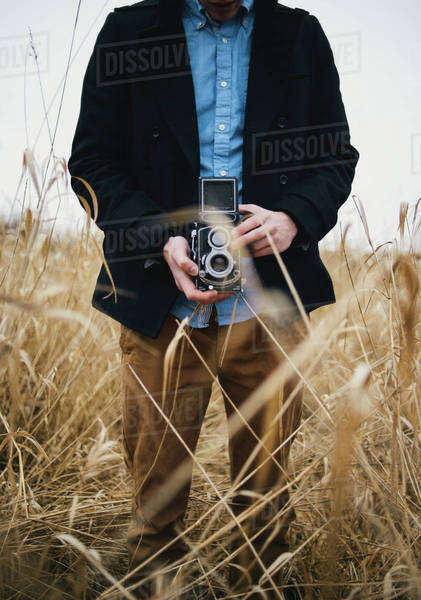 Midsection of man photographing through retro styled camera at Garry Point Park Royalty-free stock photo