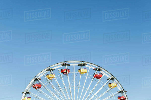 Low angle view of Ferris wheel against clear blue sky Royalty-free stock photo