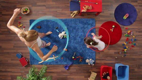 Medium shot, Lockdown, mother and daughter hula hooping, overhead view Royalty-free stock video