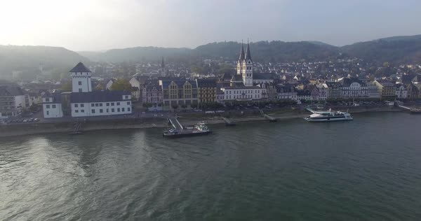 Drone shot of city buildings by river, Middle Rhine, Rhineland, Germany Royalty-free stock video