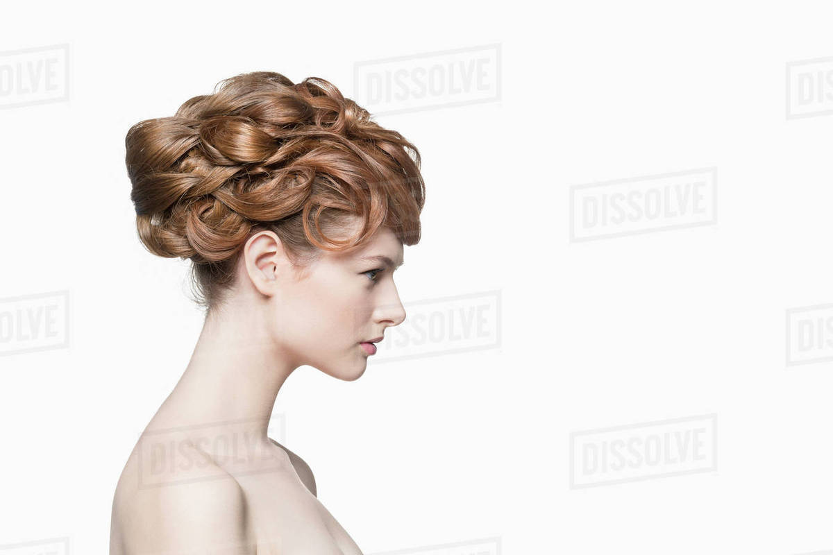 Side view of beautiful woman with hairstyle against white background