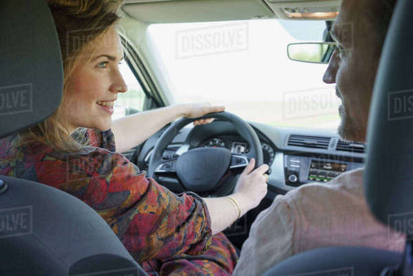 Happy couple looking at each other while traveling in car Royalty-free stock photo