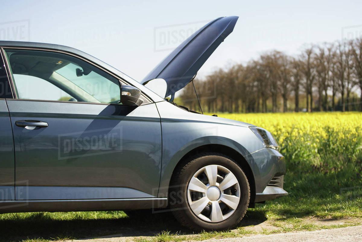 Cropped Image Of Broken Down Car On Roadside