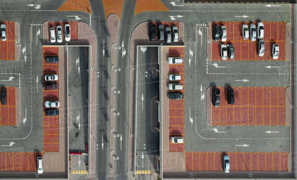 Directly above shot of cars in parking lot Royalty-free stock photo