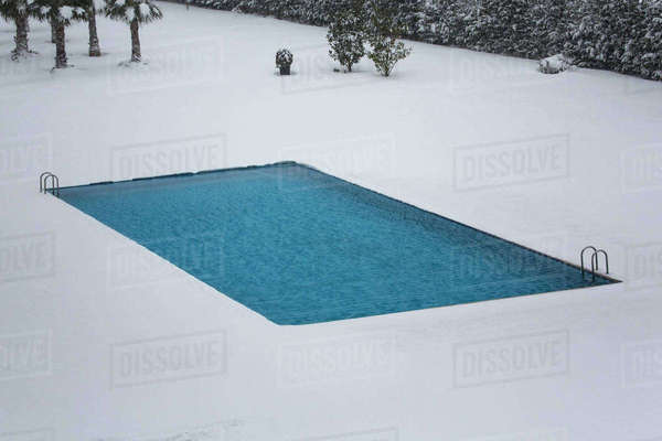 High angle view of swimming pool on snowcapped field Royalty-free stock photo