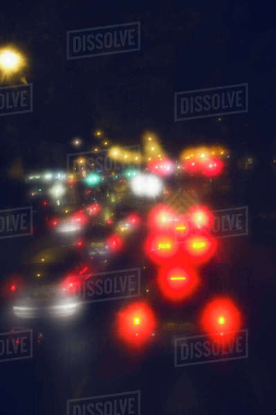 Defocused image of cars on city street at night Royalty-free stock photo