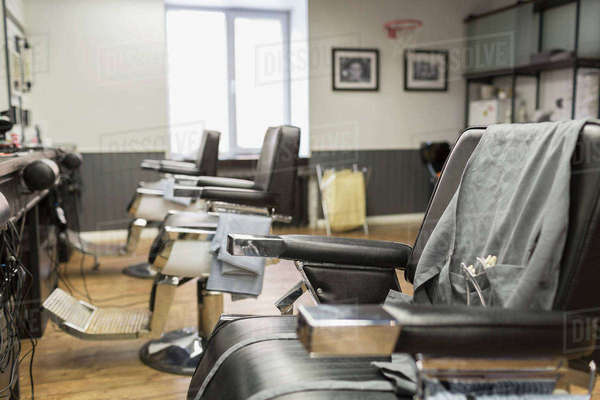 Row of empty chairs at barber shop Royalty-free stock photo