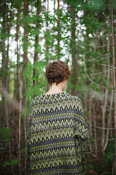 Rear view of woman standing in forest Royalty-free stock photo