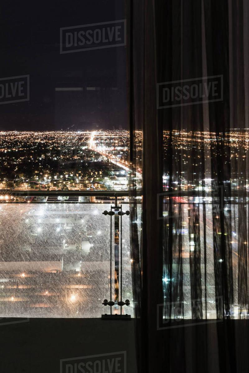 Illuminated Cityscape Seen Through Curtains On Window Las Vegas Nevada Usa