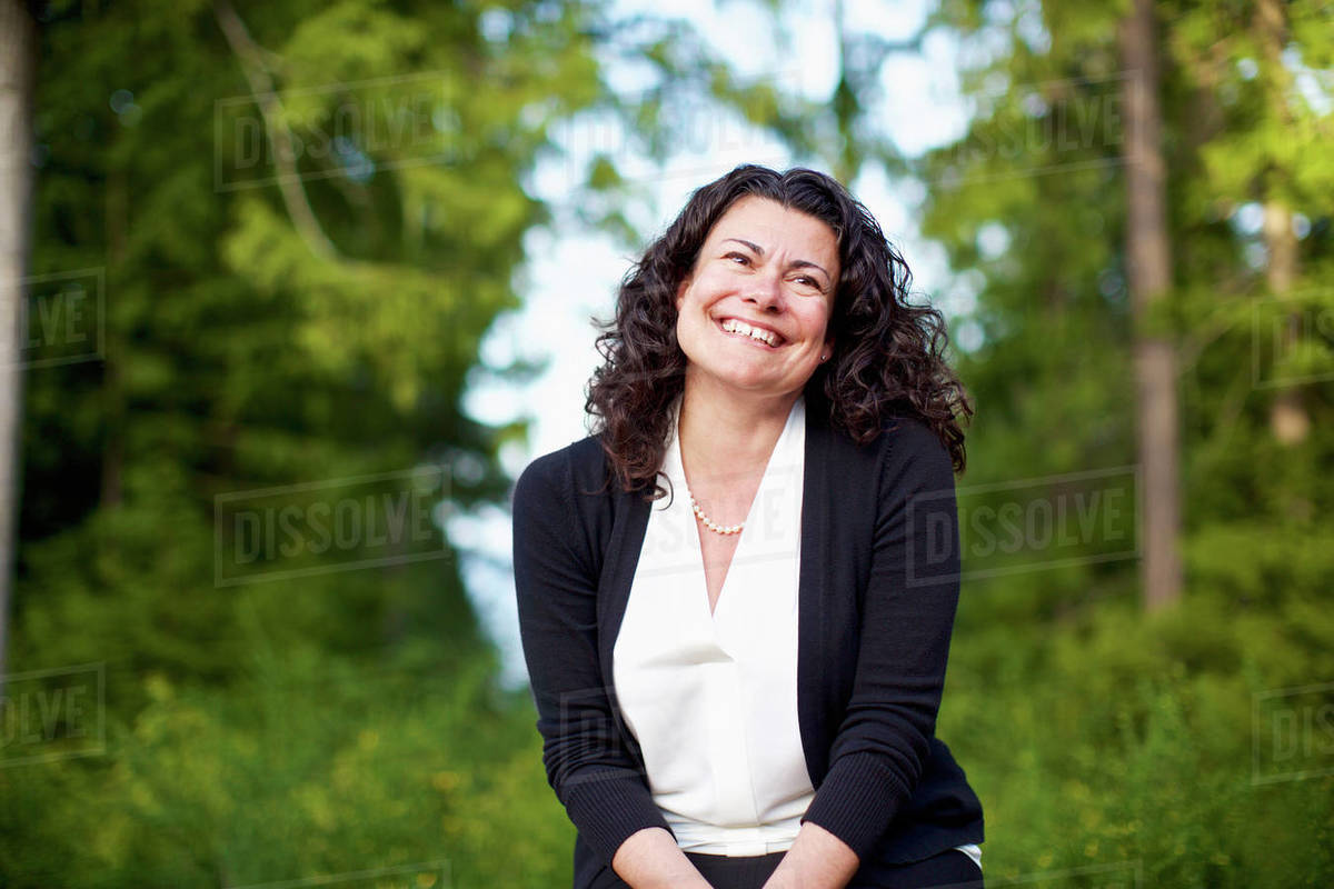 Portrait confident, happy woman smiling in woods Royalty-free stock photo