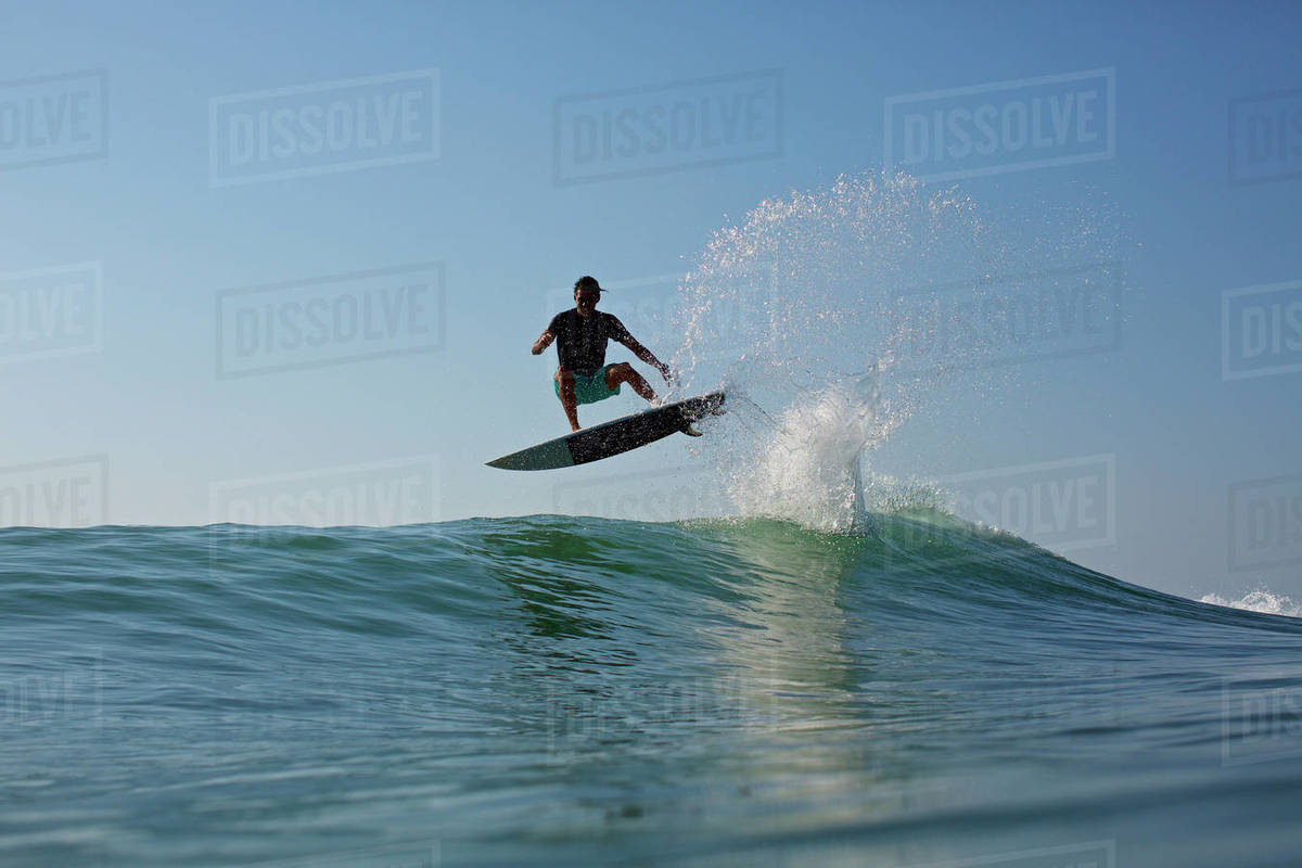 Male surfer jumping ocean wave Royalty-free stock photo
