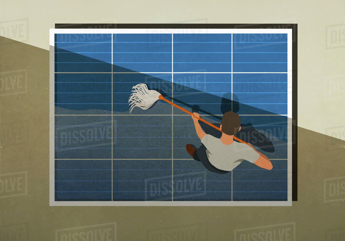 Man mopping solar panels Royalty-free stock photo