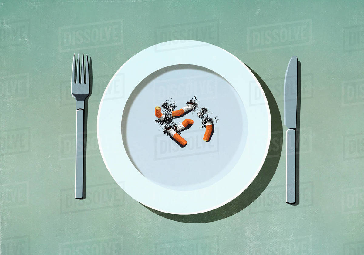 Cigarette butts on plate Royalty-free stock photo