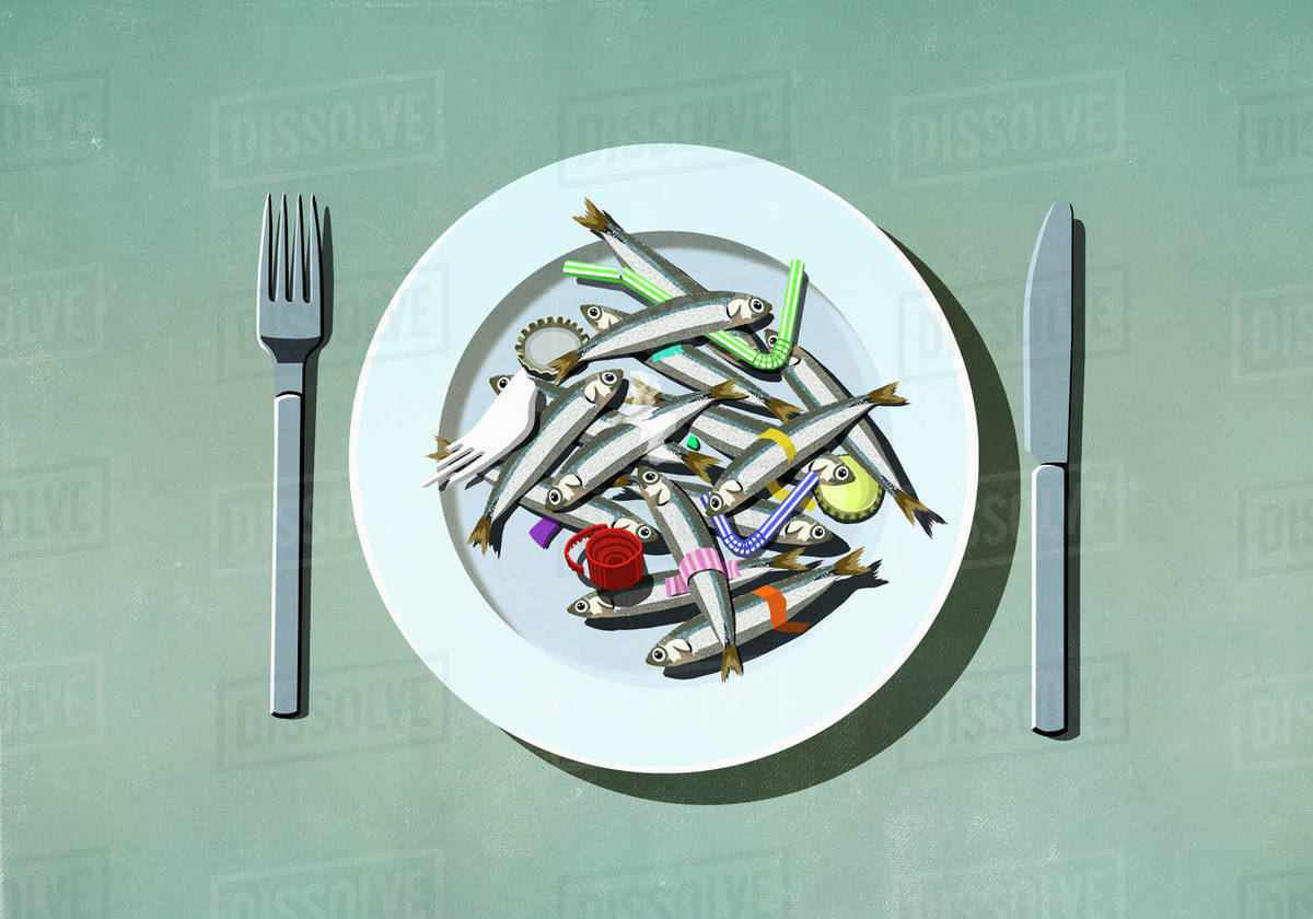Sardines, plastic straws and pollution on plate Royalty-free stock photo